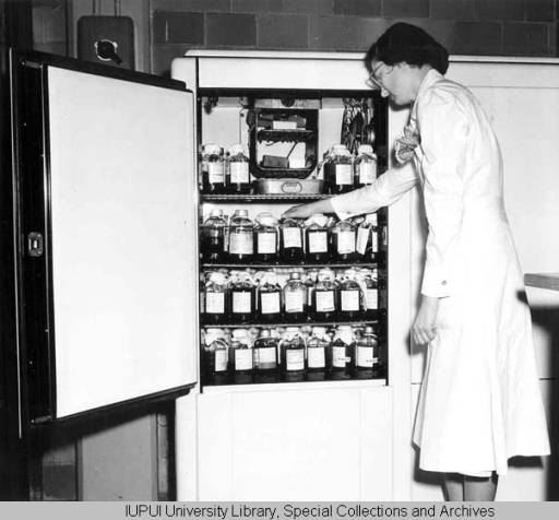 Narcy Examining the Blood Supply, ca.1945 (with a handkerchief in her front pocket)
